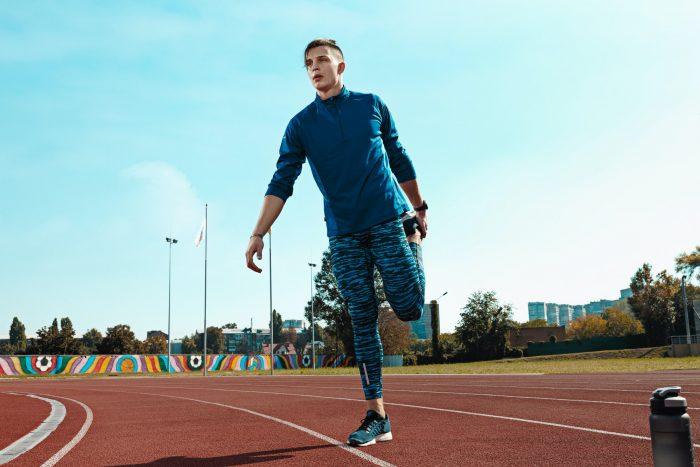 Man runner stretching legs